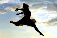 stock-photo-25291906-woman-leaping-through-the-sky